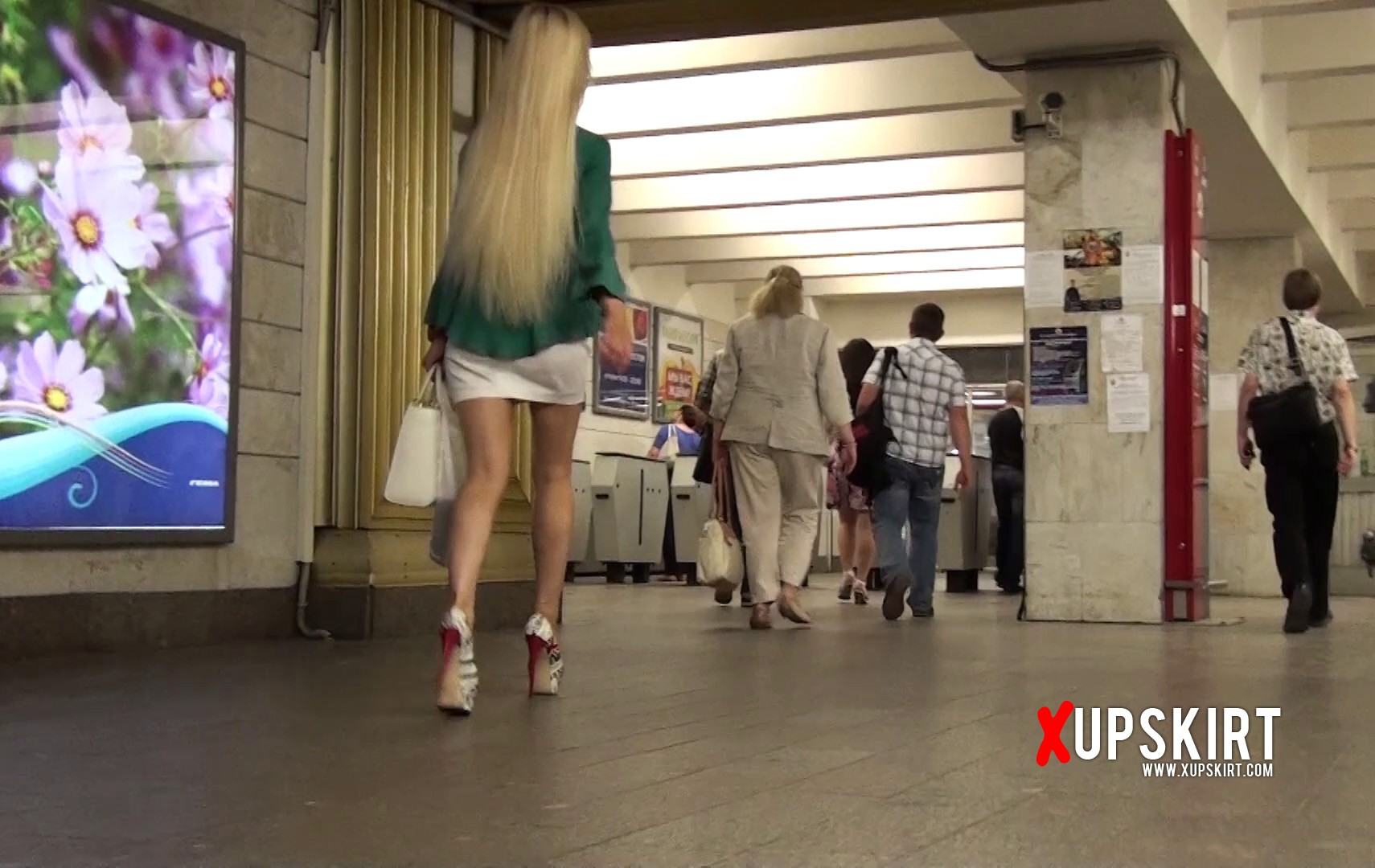 Sexy blonde in high heels with long blond hair